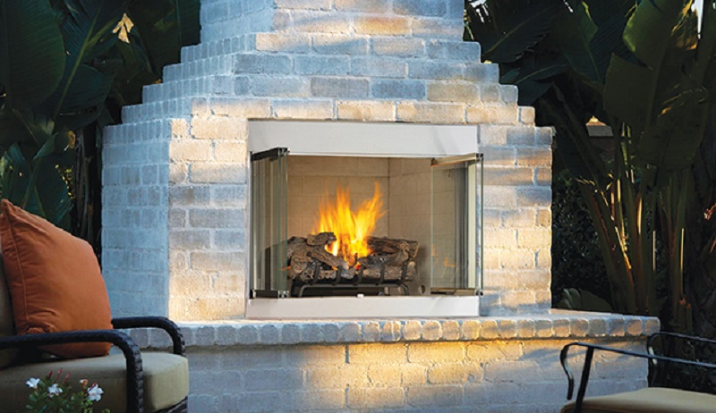 Odyssey Outdoor Gas Fireplace shown with optional doors